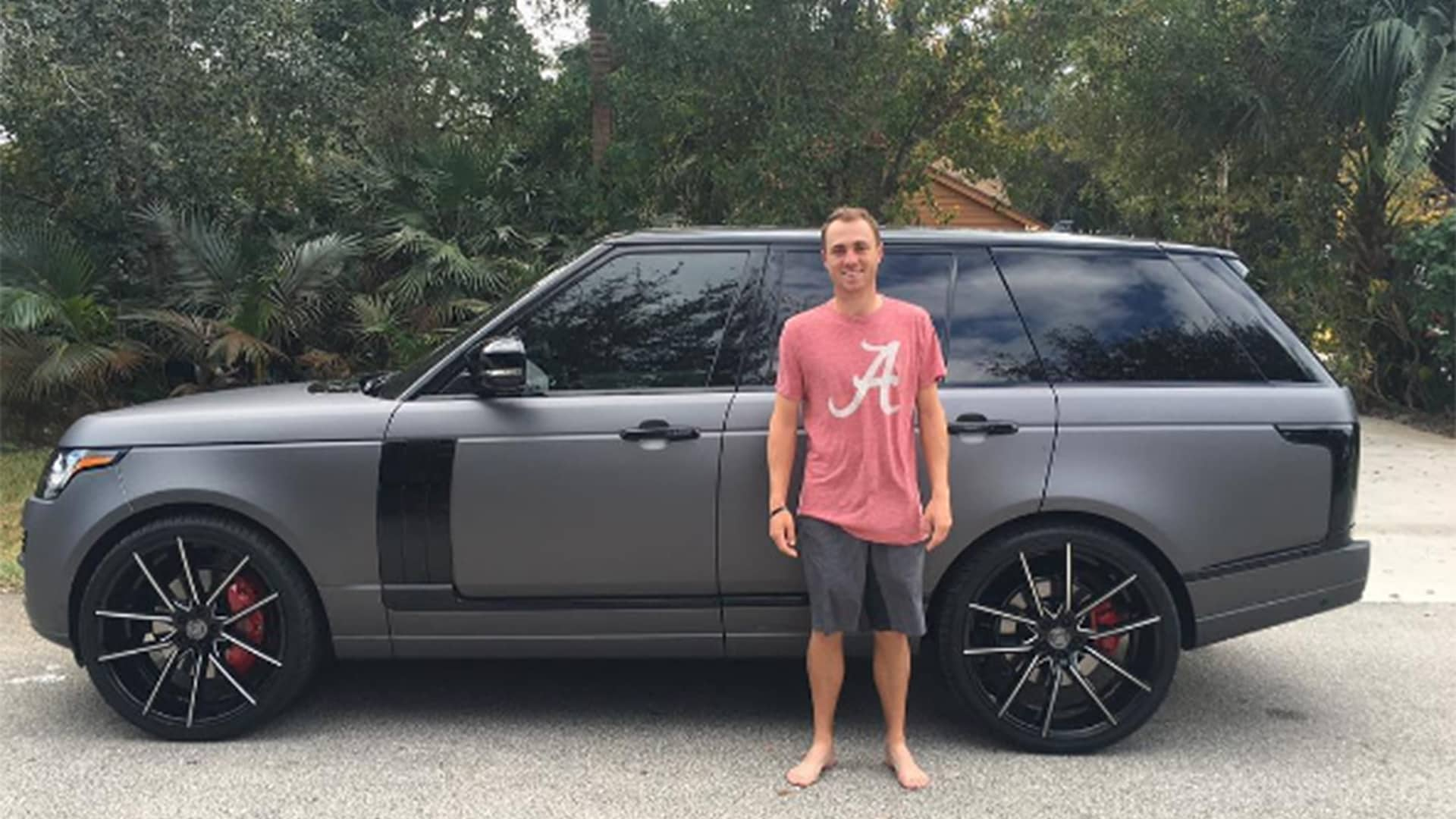 justin thomas celebrates two wins with custom range rover