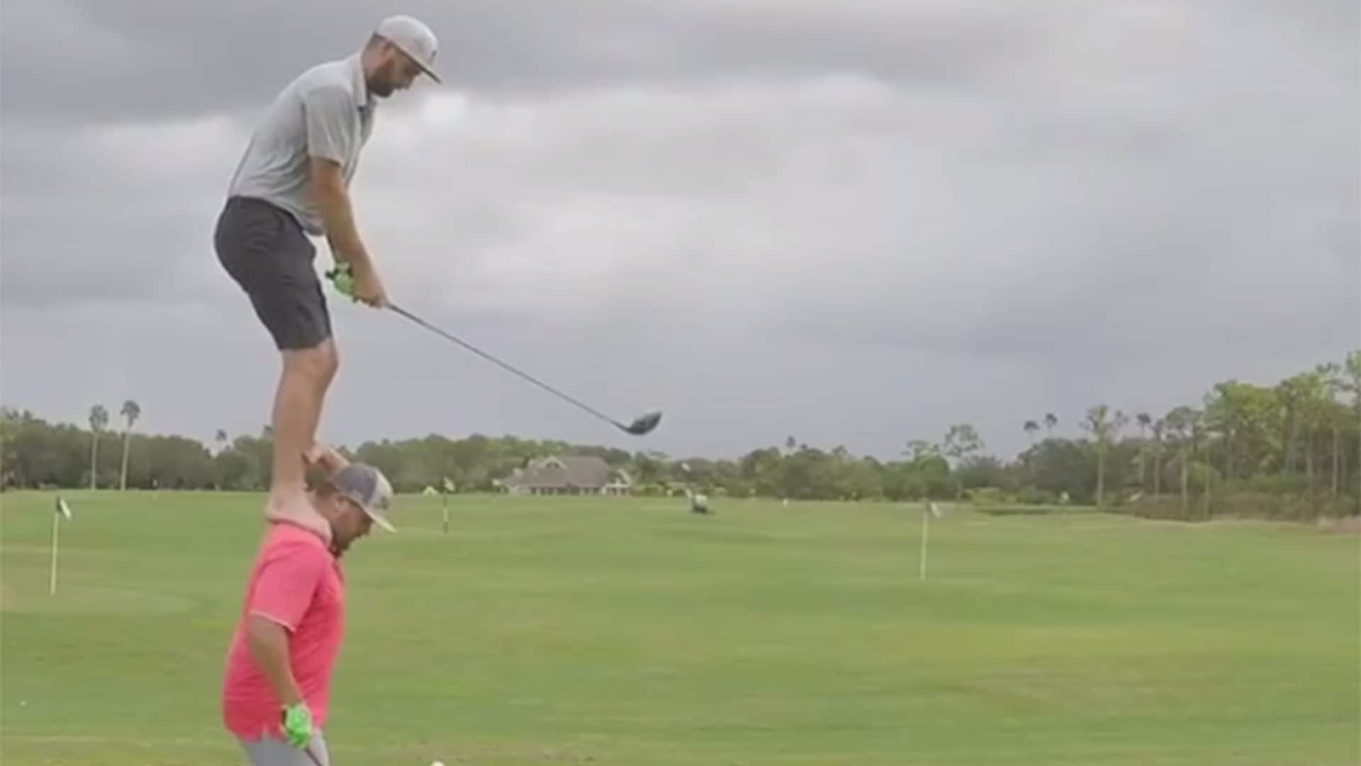 Watch: Guy stands on friend's shoulders for crazy trick shot | Golf