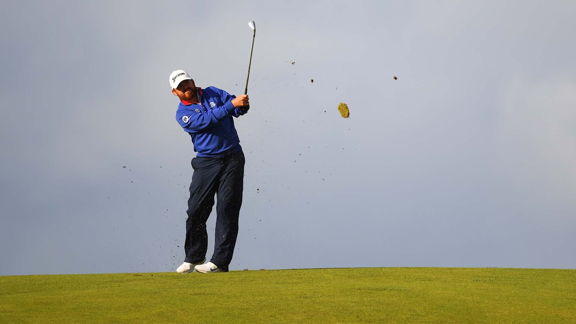 holmes  66  leads open  many big names struggle in round 1