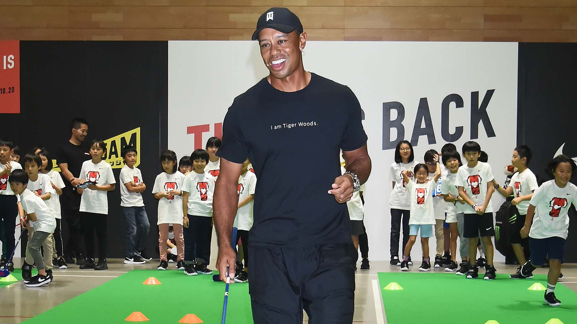 Tiger is back: Woods entertains fans at Nike store in Tokyo