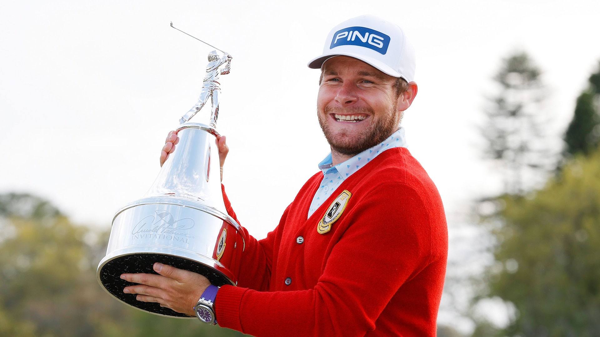 Tyrrell Hatton with API trophy and cardigan