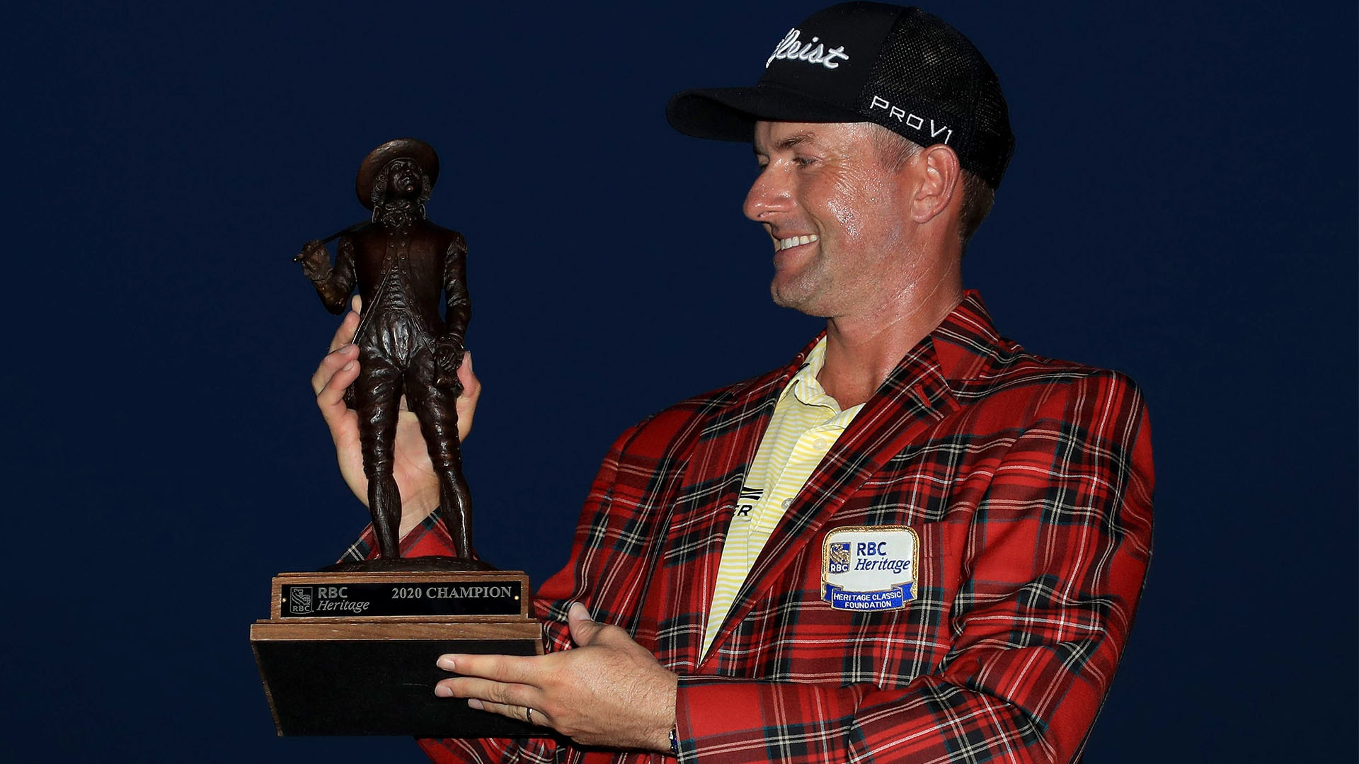 Webb Simpson with the RBC Heritage trophy and tartan jacket