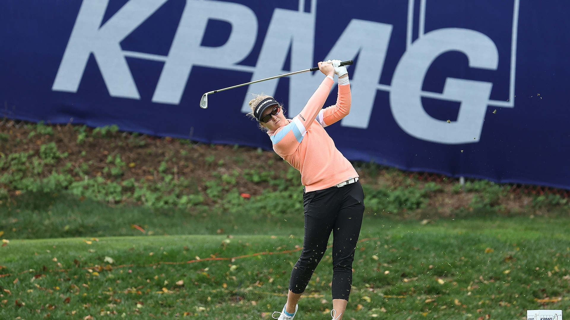 LPGA player and KPMG banner