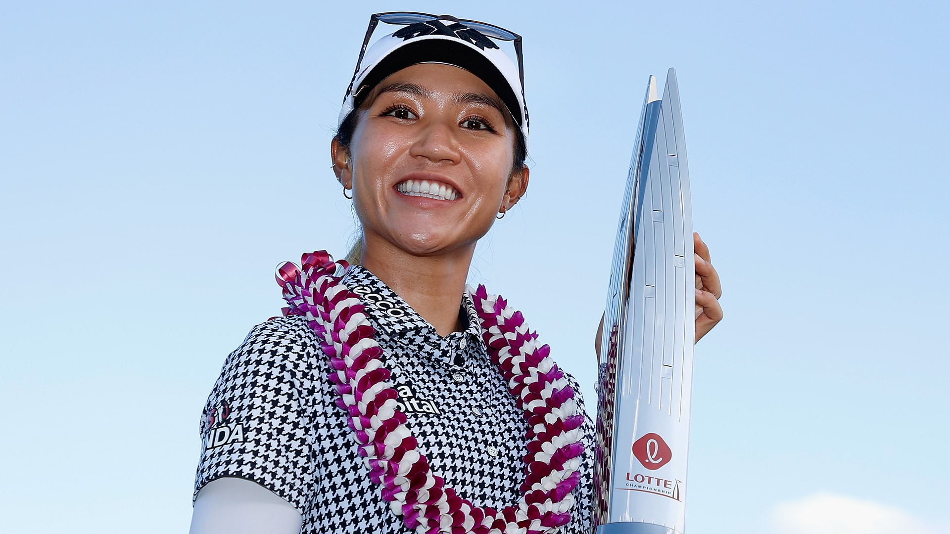 Lydia Ko holding LOTTE Championship trophy