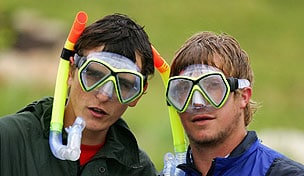 Fans wearing diving masks and snorkels