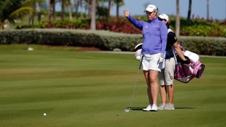 Brittany Lincicome and caddie