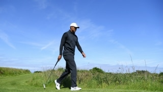Woods arrives at Royal Portrush for practice round with Reed