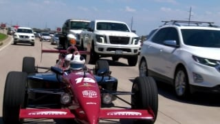 Gary Williams gets a lift from the 'street legal' 2-seater IndyCar