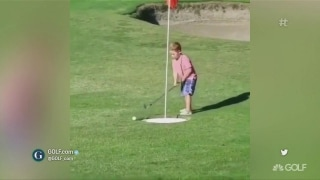 Golf is hard: Toddler battles with an oversized hole