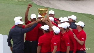 Hands on the cup: Captain Woods celebrates with the U.S. squad