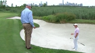 McIlroy penalized for touching sand, rescinded after round