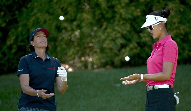 ROGERS, AR - SEPTEMBER 12:  Juli Inkster (L) and Michelle Wie juggle golf balls as they wait for their tee shot on the sixth hole during the final round of the P&G NW Arkansas Championship at the Pinnacle Country Club on September 12, 2010 in Rogers, Arkansas.  (Photo by Robert Laberge/Getty Images)