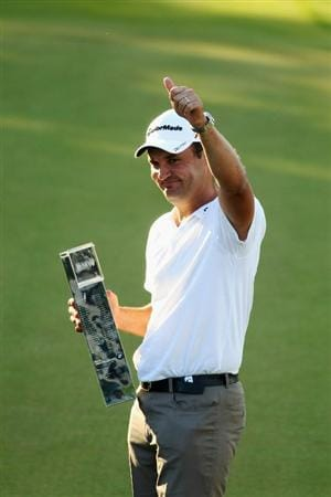 VIRGINIA WATER, ENGLAND - MAY 23:  Simon Khan of England celebrates with the trophy following his victory in the BMW PGA Championship on the West Course at Wentworth on May 23, 2010 in Virginia Water, England.  (Photo by Ian Walton/Getty Images)