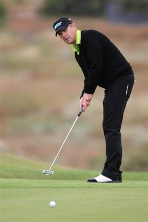 PORTO SANTO ISLAND, PORTUGAL - MAY 20:  Joakim Haeggman of Sweden putts on the 3rd hole during day two of the Madeira Islands Open on May 20, 2011 in Porto Santo Island, Portugal.  (Photo by Dean Mouhtaropoulos/Getty Images)