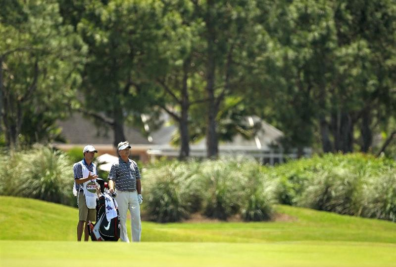 LUTZ, FL - APRIL 17:  John Cook waits to hit his approach shot on the 13th hole during the final round of the Outback Steakhouse Pro-Am at the TPC of Tampa on April 17, 2011 in Lutz, Florida.  (Photo by Mike Ehrmann/Getty Images)