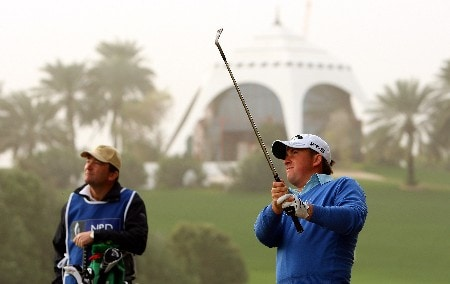 DUBAI, UNITED ARAB EMIRATES - FEBRUARY 01:  Graeme McDowell of Northern Ireland hits his second shot on the second hole during the second round of the Dubai Desert Classic on the Majilis course at Emirates Golf Club on February 1, 2008 in Dubai, United Arab Emirates.  (Photo by Andrew Redington/Getty Images)