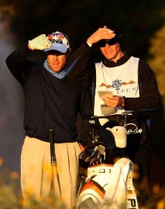 Nick O'Hern (L) of Australia and his caddy peer into the setting sun as they line up his tee shot on the fifth hole during the first round of the FBR Open on January 31, 2008 at TPC of Scottsdale in Scottdsdale, Arizona. PGA TOUR - 2008 FBR Open - Round OnePhoto by Stephen Dunn/Getty Images