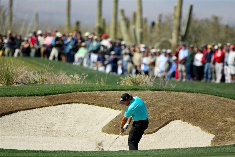 MARANA, AZ - FEBRUARY 23:  Phil Mickelson plays his second shot on the first hole froma  bunker during the first round of the Accenture Match Play Championship at the Ritz-Carlton Golf Club on February 23, 2011 in Marana, Arizona.  (Photo by Andy Lyons/Getty Images)