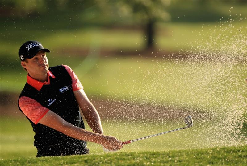 CHARLOTTE, NC - MAY 06:  Nick Watney hits a shot from the sand on the 11th hole during the second round of the Wells Fargo Championship at Quail Hollow Club on May 6, 2011 in Charlotte, North Carolina.  (Photo by Streeter Lecka/Getty Images)