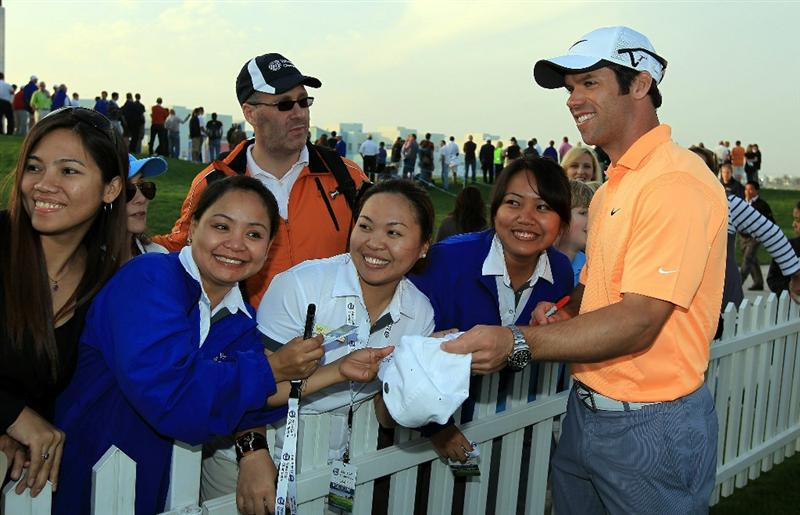 BAHRAIN, BAHRAIN - JANUARY 29:  Paul Casey of England signs autographs beside the 18th hole during the third round of the 2011 Volvo Champions held at the Royal Golf Club on January 29, 2011 in Bahrain, Bahrain.  (Photo by David Cannon/Getty Images)