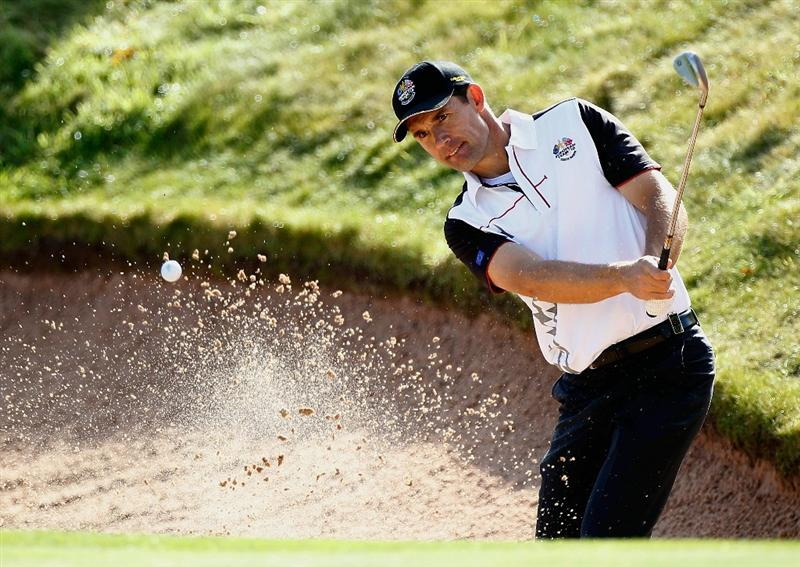 NEWPORT, WALES - SEPTEMBER 28:  Padraig Harrington of Europe hits from a bunker during a practice round prior to the 2010 Ryder Cup at the Celtic Manor Resort on September 28, 2010 in Newport, Wales.  (Photo by Sam Greenwood/Getty Images)