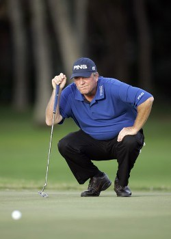 Mark Calcavecchia lines up a putt on the 11th green during the second round of the Sony Open, January 13, 2006 at the Waialae Country Club in Honolulu, Hawaii.Photo by Marco Garcia/PGA TOUR/WireImage.com