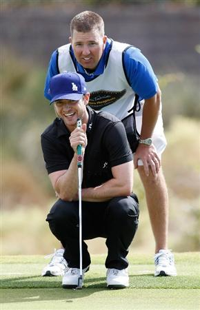 LAS VEGAS - OCTOBER 14:  Singer Justin Timberlake and his caddie Mike Prous line up Timberlake's putt on the 8th green at the Justin Timberlake Shriners Hospitals for Children Open Championship Pro-Am at the TPC Summerlin October 14, 2009 in Las Vegas, Nevada.  (Photo by Ethan Miller/Getty Images)