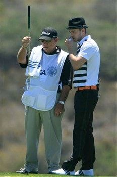 LA JOLLA, CA - JUNE 06:  Justin Timberlake reads a putt with his caddie Butch Harmon during the Golf Digest U.S. Open Challenge at the Torrey Pines Golf Course on June 6, 2008 in La Jolla, California.  (Photo by Scott Halleran/Getty Images)