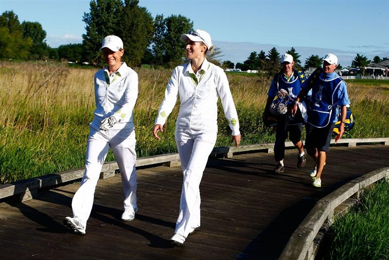 SUGAR GROVE, IL - AUGUST 22:  (L-R) Catriona Matthew and Diana Luna of the European Team walk with their caddies off the first tee during the saturday morning fourball matches at the 2009 Solheim Cup at Rich Harvest Farms on August 22, 2009 in Sugar Grove, Illinois.  (Photo by Scott Halleran/Getty Images)