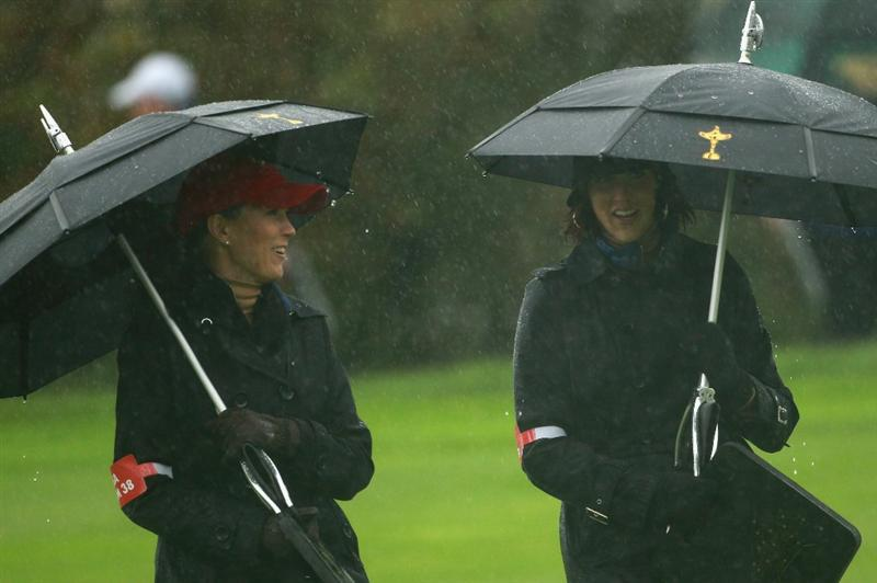 NEWPORT, WALES - OCTOBER 01:  Lisa Cink (R) and Sybil Kuchar of the USA wait under umbrellas after play was suspended during the Morning Fourball Matches during the 2010 Ryder Cup at the Celtic Manor Resort on October 1, 2010 in Newport, Wales.  (Photo by Andrew Redington/Getty Images)