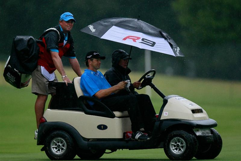 ATLANTA - SEPTEMBER 26:  Retief Goosen of South Africa rides with an official and his caddie after play was suspended for dangerous weather during the final round of THE TOUR Championship presented by Coca-Cola at East Lake Golf Club on September 26, 2010 in Atlanta, Georgia.  (Photo by Kevin C. Cox/Getty Images)