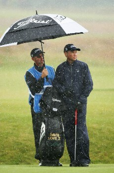 CARNOUSTIE, UNITED KINGDOM - JULY 18:  Davis Love III of the USA waits with his caddie Mike Hulbert under an umbrella during a practice round during previews to The 136th Open Championship at the Carnoustie Golf Club on July 18, 2007 in Carnoustie, Scotland.  (Photo by Ross Kinnaird/Getty Images)
