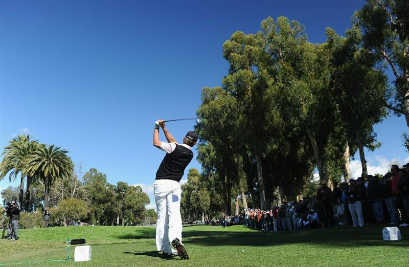 PACIFIC PALISADES, CA - FEBRUARY 20:  Aaron Baddeley of Australia plays his tee shot on the 11th hole during the final round of the Northern Trust Open at Riviera Country Club on February 20, 2011 in Pacific Palisades, California.  (Photo by Stuart Franklin/Getty Images)
