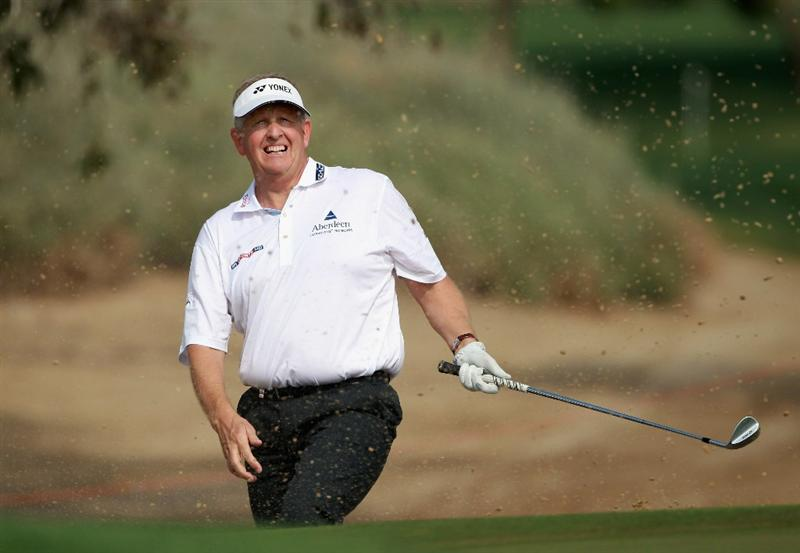 ABU DHABI, UNITED ARAB EMIRATES - JANUARY 22:  Colin Montgomerie of Scotland plays a bunker shot on the tenth hole during the third round of The Abu Dhabi HSBC Golf Championship at Abu Dhabi Golf Club on January 22, 2011 in Abu Dhabi, United Arab Emirates.  (Photo by Andrew Redington/Getty Images)