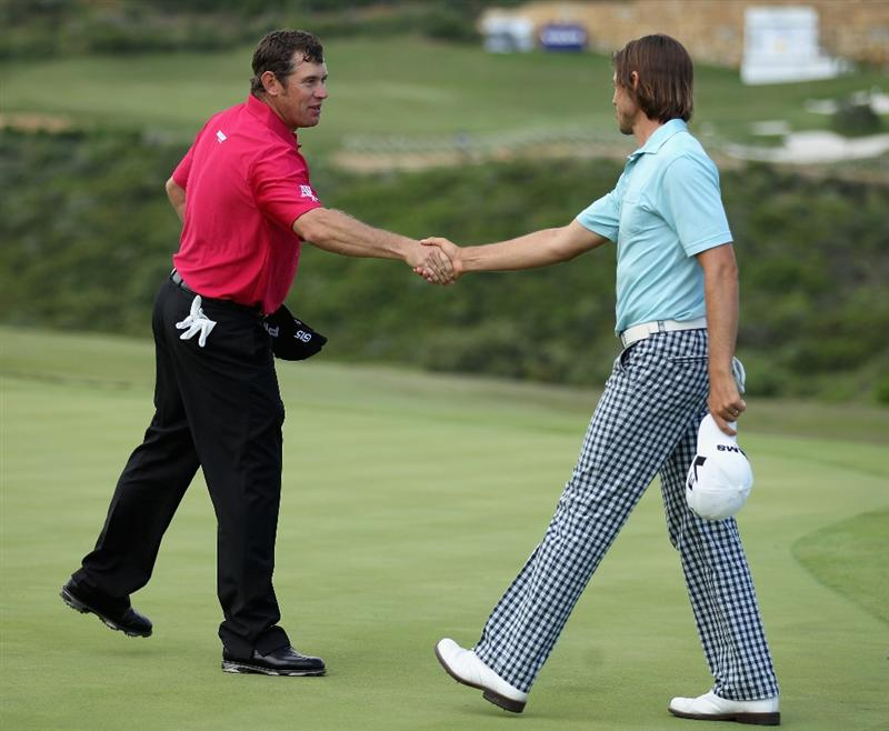 CASARES, SPAIN - MAY 20:  Lee Westwood of England shakes hands with Aaron Baddeley of Australia during the group stages of the Volvo World Match Play Championships at Finca Cortesin on May 20, 2011 in Casares, Spain.  (Photo by Warren Little/Getty Images)