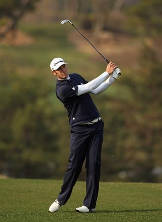 ICHEON, SOUTH KOREA - APRIL 29:  Dustin Johnson of the USA hits his second shot on the 11th hole during the second round of the Ballantine's Championship at Blackstone Golf Club on April 29, 2011 in Icheon, South Korea.  (Photo by Andrew Redington/Getty Images)
