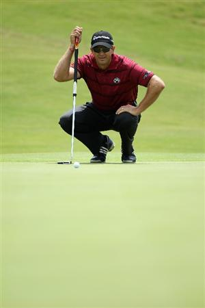CASARES, SPAIN - MAY 19:  Retief Goosen of South Africa lines up a putt on the second green during the group stages of the Volvo World Match Play Championships at Finca Cortesin on May 19, 2011 in Casares, Spain.  (Photo by Warren Little/Getty Images)