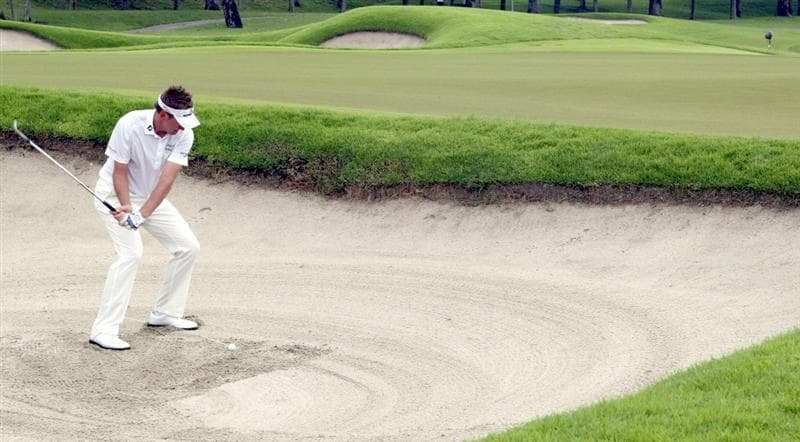 SINGAPORE - NOVEMBER 15: Ian Poulter of England plays a bunker shot on the 16th hole during the Final Round of the Barclays Singapore Open held at the Sentosa Golf Club on November 15, 2010 in Singapore, Singapore.  (Photo by Stanley Chou/Getty Images)