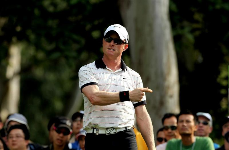 HONG KONG - NOVEMBER 21:  Simon Dyson of England reacts to a tee shot on the 12th hole during day four of the UBS Hong Kong Open at The Hong Kong Golf Club on November 21, 2010 in Hong Kong.  (Photo by Stanley Chou/Getty Images)