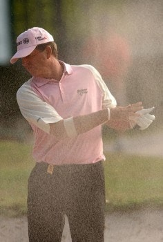 Dana Quigley reacts to a blast of sand on his second shot on the 18th green during the final round of the Champion's TOUR 2005 SBC Championship at Oak Hill Country Club in San Antonio, Texas October 23, 2005.Photo by Steve Grayson/WireImage.com