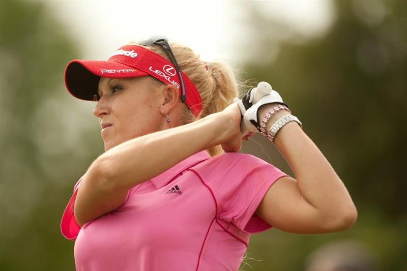 SPRINGFIELD, IL - JUNE 10: Natalie Gulbis follows through on a tee shot during the first round of the LPGA State Farm Classic at Panther Creek Country Club on June 10, 2010 in Springfield, Illinois. (Photo by Darren Carroll/Getty Images)