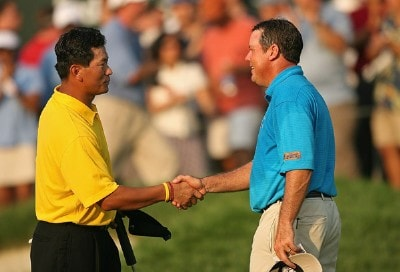 KJ Choi and Rich Beem shake hands on the 18th hole during the third round of The Barclays, the inaugural event of the new PGA TOUR Playoffs for the FedExCup at Westchester Country Club on August 25, 2007 in Harrison, New York. PGA TOUR - 2007 The Barclays - Third RoundPhoto by M. Ehrmann/WireImage.com