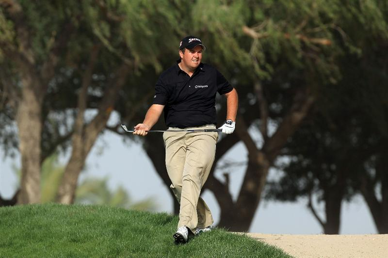 DUBAI, UNITED ARAB EMIRATES - FEBRUARY 04:  Shane Lowry of Ireland watches his second shot at the par 5, 13th hole during the first round of the 2010 Omega Dubai Desert Classic on the Majilis Course at the Emirates Golf Club on February 4, 2010 in Dubai, United Arab Emirates.  (Photo by David Cannon/Getty Images)