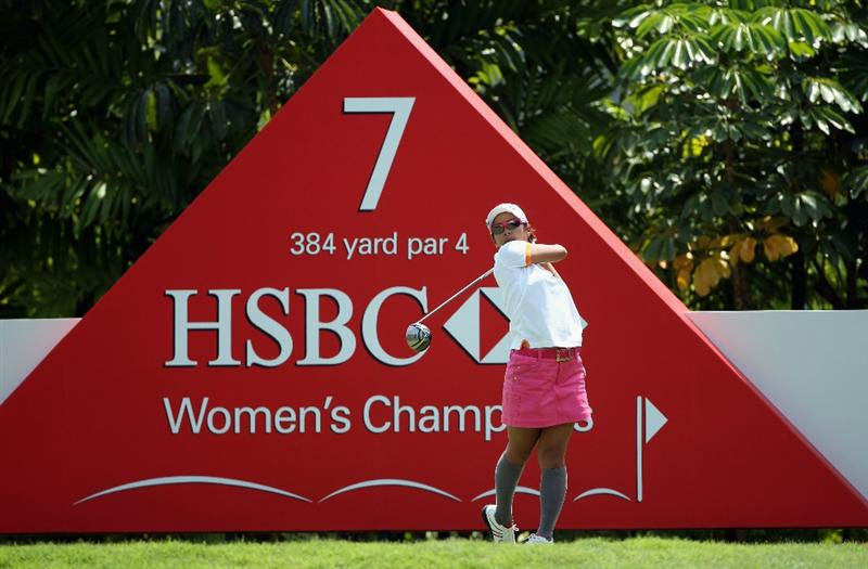 SINGAPORE - FEBRUARY 24:  Ai Miyazato of Japan hits her tee-shot on the seventh hole during the first round of the HSBC Women's Champions at the Tanah Merah Country Club on February 24, 2011 in Singapore.  (Photo by Andrew Redington/Getty Images)