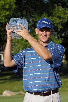 Jason Schultz holds up the championship trophy during the Final Round of the Chattanooga Classic  at Black Creek Club in Chattanooga, Tennessee on June 5, 2005.Photo by Joe Murphy/WireImage.com