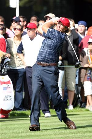 SAN FRANCISCO - OCTOBER 09:  Phil Mickelson of the USA Team drives at the 6th hole watched by his playing partner Justin Leonard during the Day Two Fourball Matches in The Presidents Cup at Harding Park Golf Course on October 9, 2009 in San Francisco, California  (Photo by David Cannon/Getty Images)