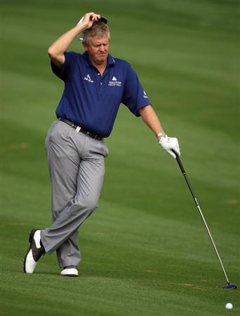 DUBAI, UNITED ARAB EMIRATES - JANUARY 28:  Colin Montgomerie of Scotland on the par five 10th hole during the pro-am event prior to the Dubai Desert Classic on the Majlis Course on January 28, 2009 in Dubai, United Arab Emirates.  (Photo by Ross Kinnaird/Getty Images)