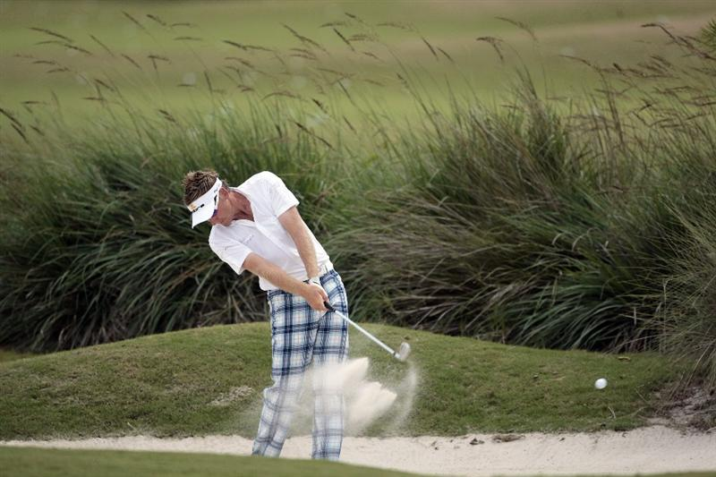 AVONDALE, LA - APRIL 26: Ian Poulter of England hits from a fairway bunker on the 1st hole during the final round of the Zurich Classic at TPC Louisiana on April 26, 2009  in Avondale, Louisiana. (Photo by Dave Martin/Getty Images)