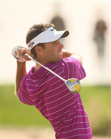 MARANA, AZ - FEBRUARY 19:  Charl Schwartzel of South Africa tees off on the fifth tee box during round three of the Accenture Match Play Championship at the Ritz-Carlton Golf Club on February 19, 2010 in Marana, Arizona.  (Photo by Darren Carroll/Getty Images)