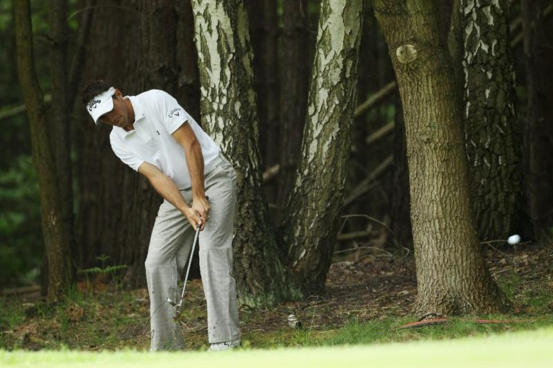 VIRGINIA WATER, ENGLAND - MAY 20:  Nick Dougherty of England plays his second shot at the 13th hole during the first round of the BMW PGA Championship on the West Course at Wentworth on May 20, 2010 in Virginia Water, England.  (Photo by David Cannon/Getty Images)